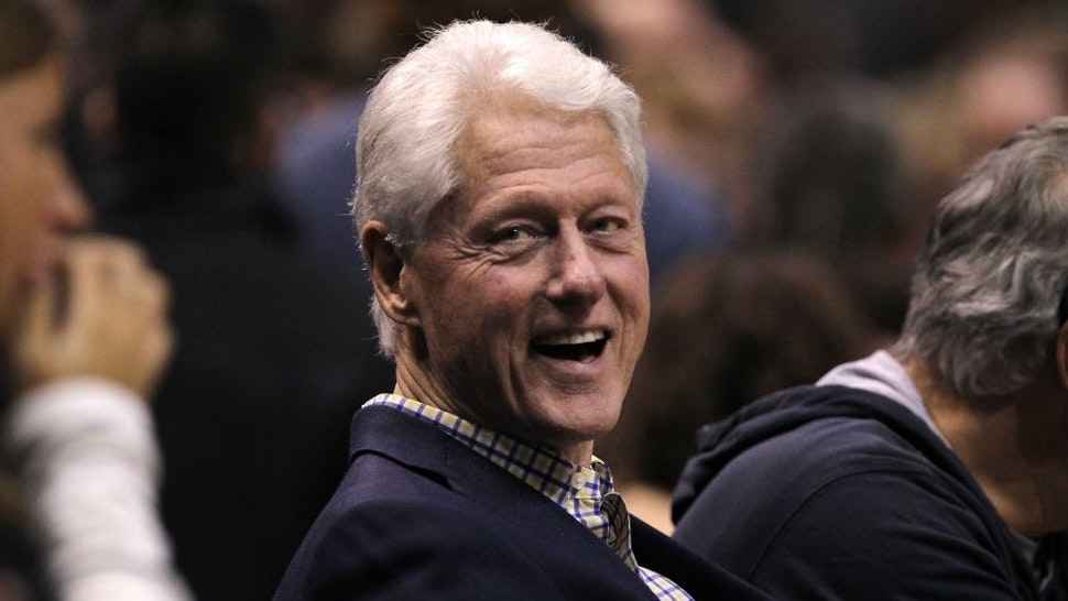 MILWAUKEE, WI - APRIL 26: Former President of the United States Bill Clinton looks on during Game Six of Round One of the 2018 NBA Playoffs between the Milwaukee Bucks and Boston Celtics at the Bradley Center on April 26, 2018 in Milwaukee, Wisconsin. NOTE TO USER: User expressly acknowledges and agrees that, by downloading and or using this photograph, User is consenting to the terms and conditions of the Getty Images License Agreement. (Photo by