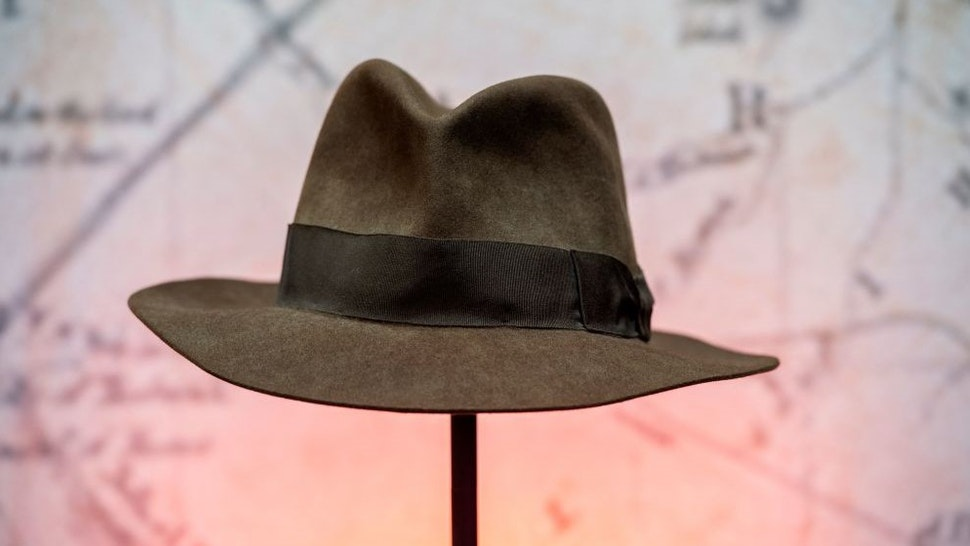 """Harrison Ford's Indiana Jones' fedora hat from the movie """"Indiana Jones & the Temple of Doom"""" is exhibited during a press preview of Prop Store's Iconic Film & TV Memorabilia on May 14, 2021, in Valencia, California. - Over 1,200 items from Hollywood folklore will go on sale in June and July, including Princess Leia actor Carrie Fisher's """"Star Wars: The Empire Strikes Back"""" script, the custom-made hat worn by Harrison Ford in 1984 action classic """"Indiana Jones and the Temple of Doom"""" and Tom Cruise's sword from """"The Last Samurai."""" (Photo by VALERIE MACON / AFP) (Photo by"""