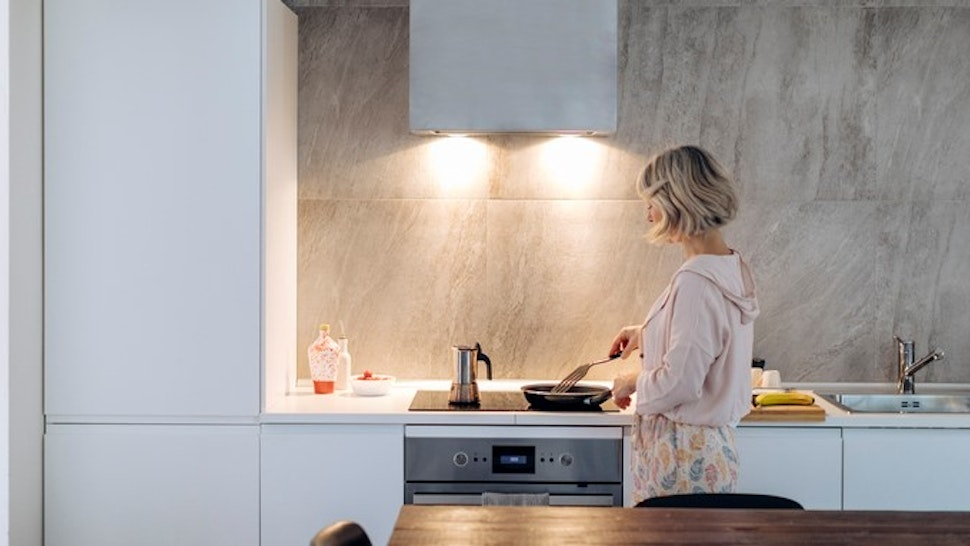 Mature woman cooking in kitchen at home
