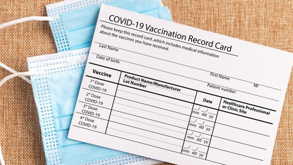 Coronavirus vaccination record card. Protective mask divided into two parts. Concept of defeating Covid-19