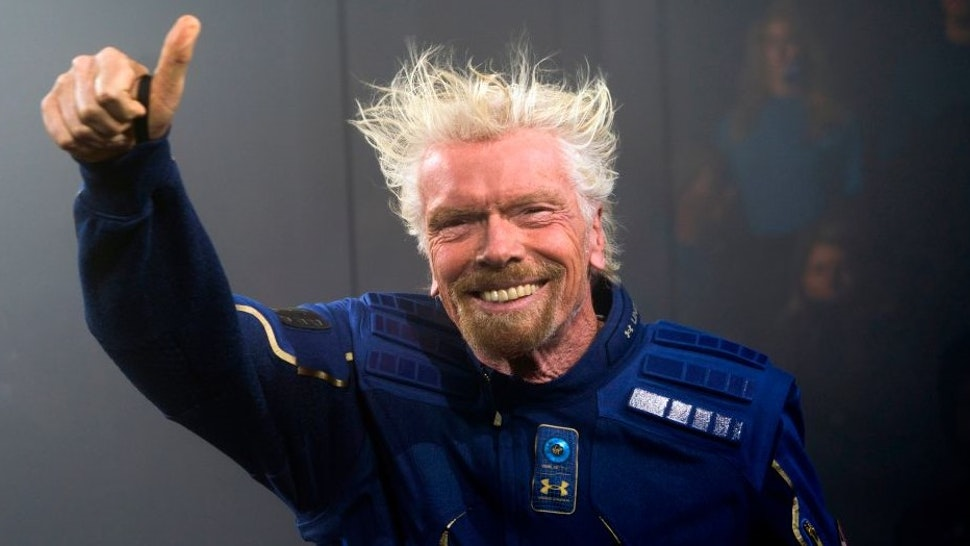 Virgin Galactic Founder Sir Richard Branson demonstrates a spacewear system, designed for Virgin Galactic astronauts, at an event October 16, 2019 in Yonkers, New York. - At the event Virgin Galactic and Under Armour unveiled the worlds first exclusive spacewear system for private astronauts. (Photo by Don Emmert / AFP) (Photo by