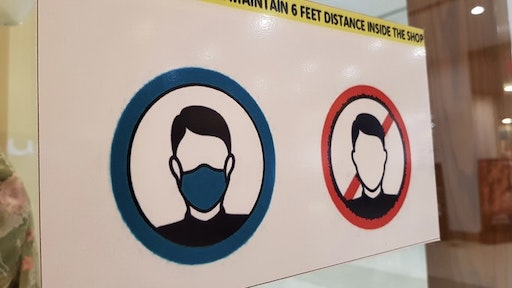 Safety or warning signs for wearing surgical face mask before entering in shops during Corona Virus (Covid-19) pandemic. - stock photo Corona Virus precautionary and safety signs on and near shops in the markets. Amir Mukhtar via Getty Images