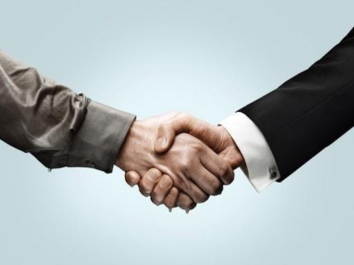 Handshakes - stock photo Holloway via Getty Images