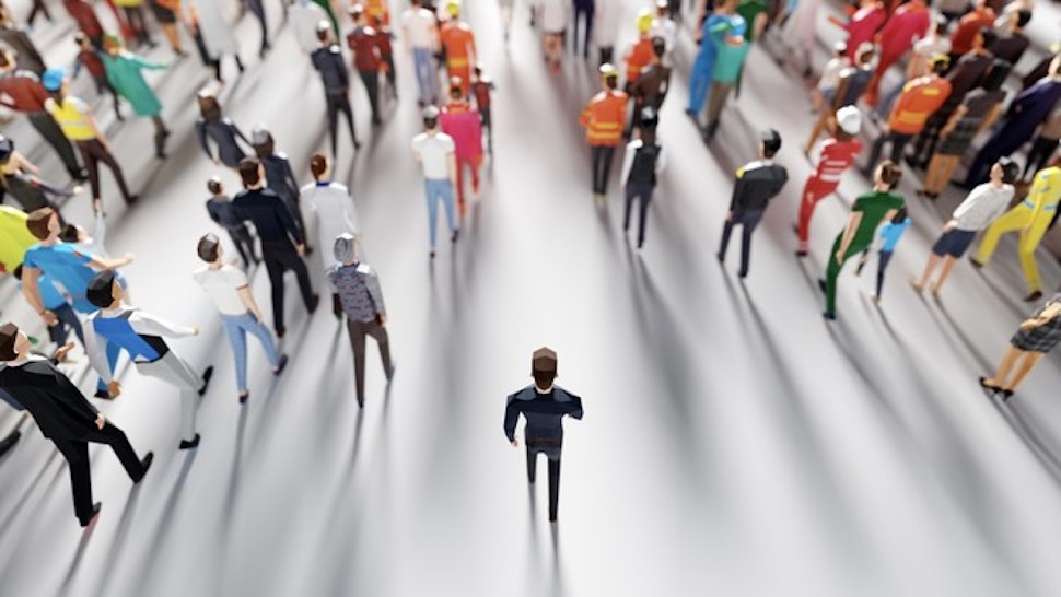 Businessman following crowd of people. Low poly style. - stock photo Businessman following crowd of people walking in one direction. Low poly style. Society and business world. Conceptual 3D illustration NiseriN via Getty Images