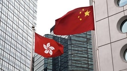 Hong Kong and China - stock photo Hong Kong and China flags against commercial buildings ymgerman via Getty Images