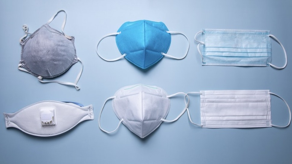 different types of protective face mask against blue background - stock photo different types of protective face mask against blue background Kilito Chan via Getty Images