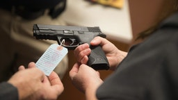 Customers shop for a handgun at Metro Shooting Supplies on November 12, 2014 in Bridgeton, Missouri.