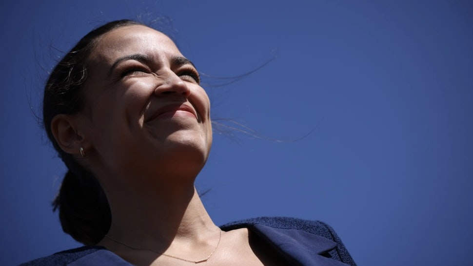Reps. Ocasio-Cortez And Moulton Call For Increased Funding For High-Speed Rail WASHINGTON, DC - JUNE 16: Rep. Alexandria Ocasio-Cortez (D-NY) listens to speakers during an event outside Union Station June 16, 2021 in Washington, DC. Ocasio-Cortez, joined by Rep. Seth Moulton (D-NY) and Sen. Kirsten Gillibrand (D-NY), called for increased federal funding for high speed-rail in the infrastructure package being discussed on Capitol Hill. (Photo by Win McNamee/Getty Images) Win McNamee / Staff via Getty Images