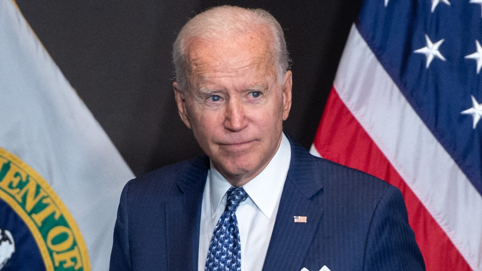 US President Joe Biden leaves after addressing the Intelligence Community workforce and its leadership while on a tour at the Office of the Director of National Intelligence in McLean, Virginia, on July 27, 2021.