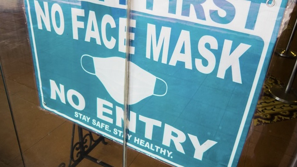 No Mask No Entry sign in a store window - stock photo Close-up view of No Mask No Entry sign in a store window amidst Coronavirus Pandemic Karl Tapales via Getty Images