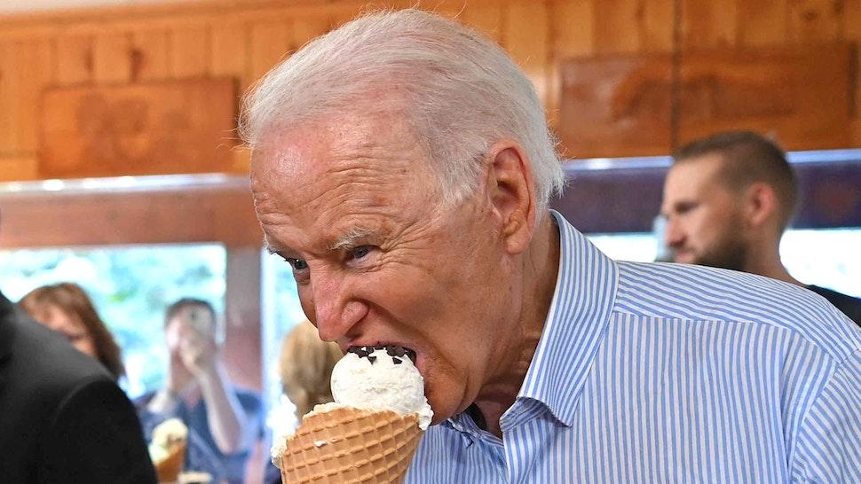US President Joe Biden eats ice cream at Moomers Homemade Ice Cream in Traverse City, Michigan on July 3, 2021.
