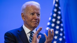 U.S. President Joe Biden applauds as First Lady Jill Biden, not pictured, speaks during the National Education Association's annual meeting and representative assembly event in Washington, D.C., U.S., on Friday, July 2, 2021.