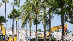 Florida, Miami, Surfside Building Collapse, pile of debris with heavy equipment to help remove