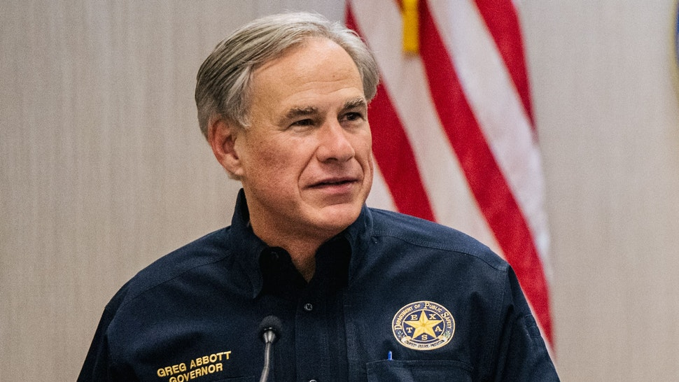 WESLACO, TEXAS - JUNE 30: Texas Gov. Greg Abbott addresses former President Donald Trump during a border security briefing to discuss further plans in securing the southern border wall on June 30, 2021 in Weslaco, Texas. Gov. Abbott has pledged to build a state-funded border wall between Texas and Mexico as a surge of mostly Central American immigrants crossing into the United States has challenged U.S. immigration agencies. So far in 2021, U.S. Border Patrol agents have apprehended more than 900,000 immigrants crossing into the United States on the southern border.