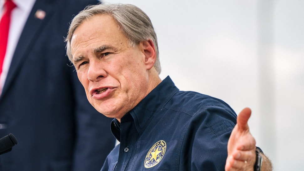 PHARR, TEXAS - JUNE 30: Texas Gov. Greg Abbott speaks alongside former President Donald Trump during a tour to an unfinished section of the border wall on June 30, 2021 in Pharr, Texas. Gov. Abbott has pledged to build a state-funded border wall between Texas and Mexico as a surge of mostly Central American immigrants crossing into the United States has challenged U.S. immigration agencies. So far in 2021, U.S. Border Patrol agents have apprehended more than 900,000 immigrants crossing into the United States on the southern border.