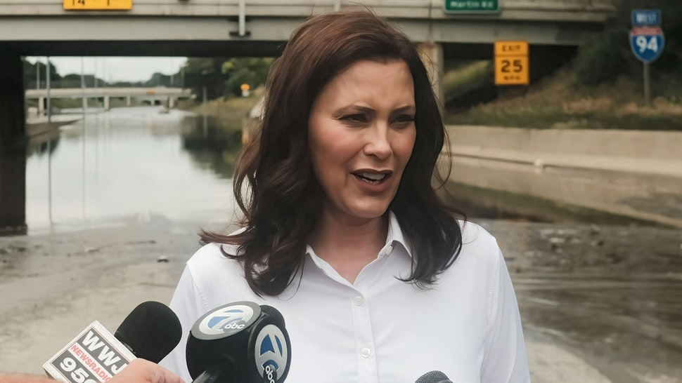 DETROIT, MICHIGAN, UNITED STATES - 2021/06/28: Michigan Governor Gretchen Whitmer speaks to members of the press during a press conference held on the still inundated I-94 in Detroit. After a weekend of heavy storms beginning on Friday night and lasting through the weekend rainwater flooded parts of I-94 in Detroit, Michigan forcing some motorists to abandon their vehicles and seek shelter from the heavy rains. Flood waters remained in areas along I-94 between Dearborn and Downtown Detroit several days later as Michigan Governor Gretchen Whitmer held a press conference on the still inundated I-94.