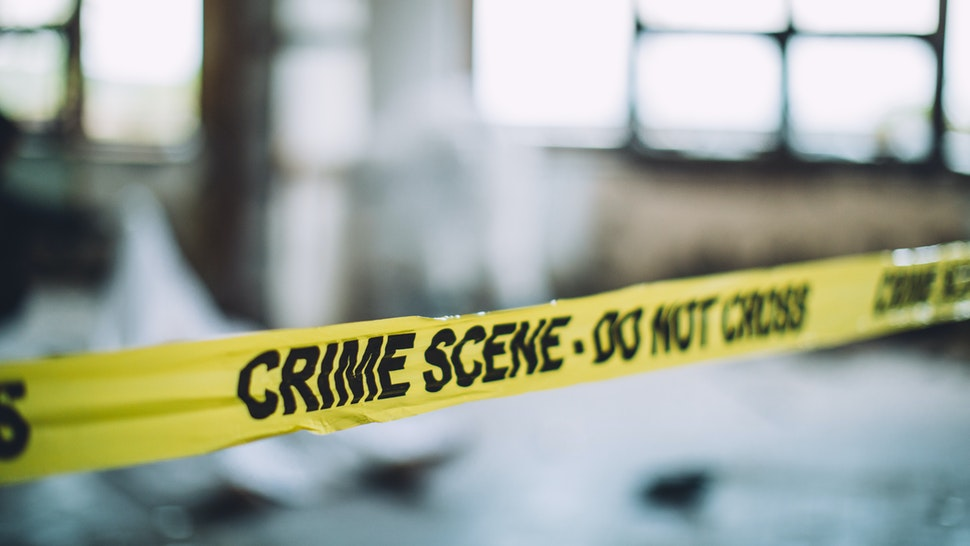Detectives and forensics on murder crime scene collecting evidence