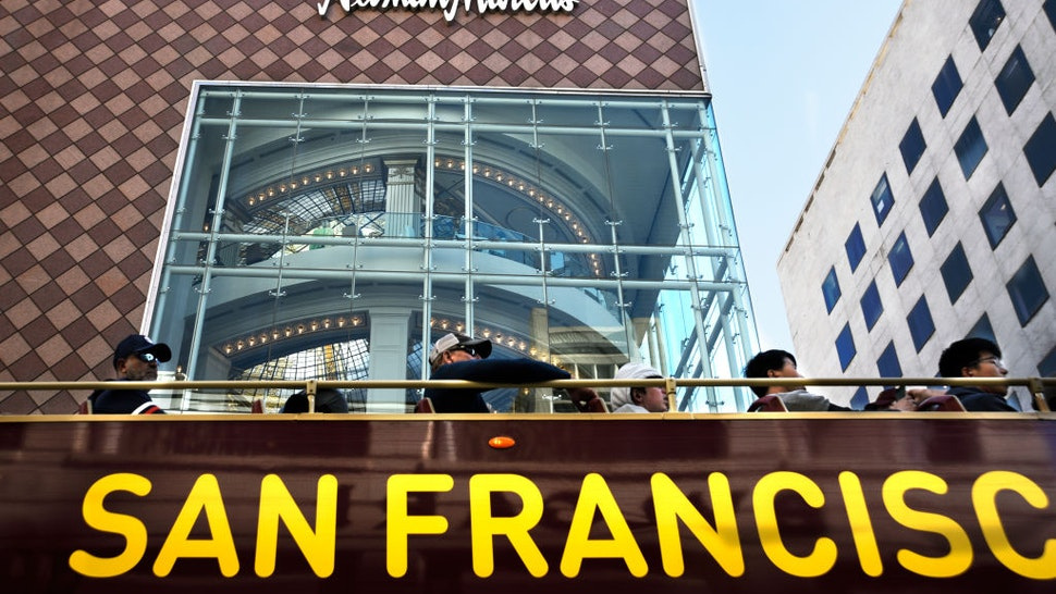 SAN FRANCISCO, CALIFORNIA - SEPTEMBER 13, 2018: Tourists ride a sightseeing bus past a Neiman Marcus store in San Francisco, California. (Photo by Robert Alexander/Getty Images)