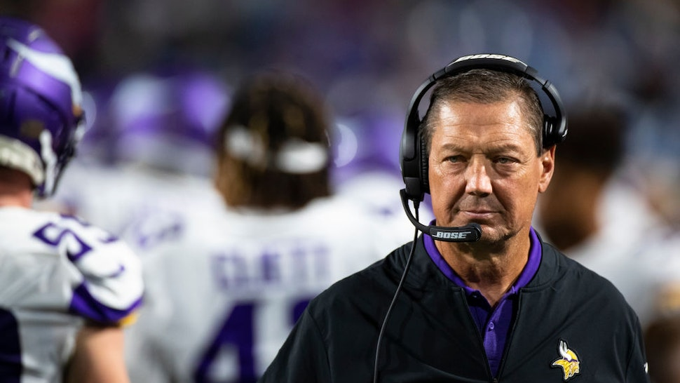 Offensive line coach Rick Dennison of the Minnesota Vikings walks the sideline during the second half of a preseason game against the Buffalo Bills at New Era Field on August 29, 2019 in Orchard Park, New York.