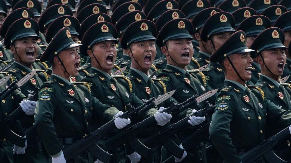 BEIJING, CHINA - OCTOBER 01: Chinese soldiers shout as they march in formation during a parade to celebrate the 70th Anniversary of the founding of the People's Republic of China at Tiananmen Square in 1949, on October 1, 2019 in Beijing, China.