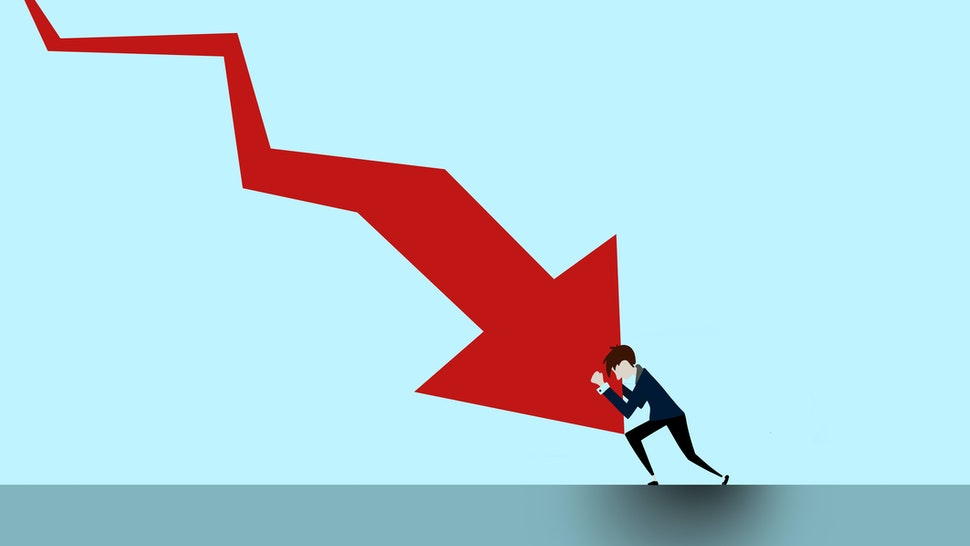 Arrow going down and question mark and man stopping it - stock photo
