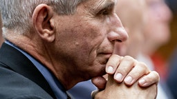 Anthony Fauci, director of the National Institute of Allergy and Infectious Diseases, listens during a House Energy and Commerce Subcommittee on Health hearing in Washington, D.C., U.S., on Wednesday, Feb. 26, 2020. Top U.S. health officials described a range of measures the government could take if the outbreak of coronavirus that began in China spreads widely in the U.S., outlining emergency plans that could result in significant disruptions to daily life for some.