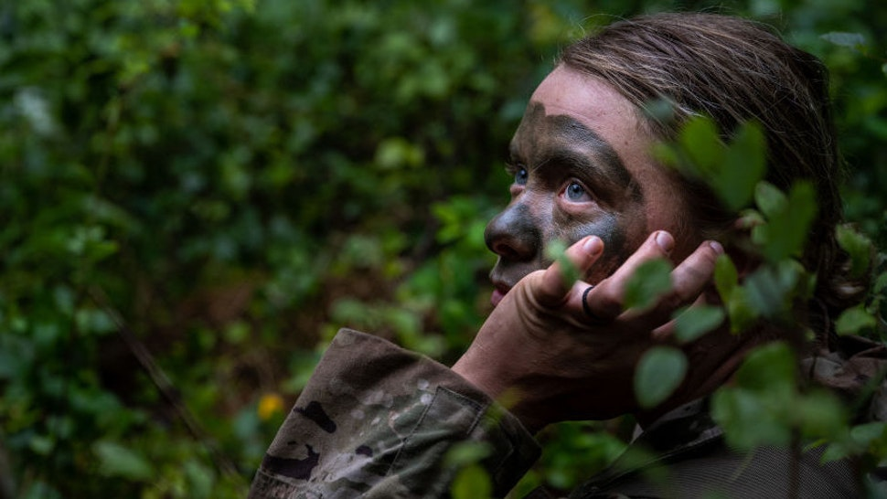 A cadet of the 3rd Regiment listens to a nearby speaking cadet in Training Area 9 during Army ROTC Cadet Summer Training on July 1, 2021 in Fort Knox, Kentucky.