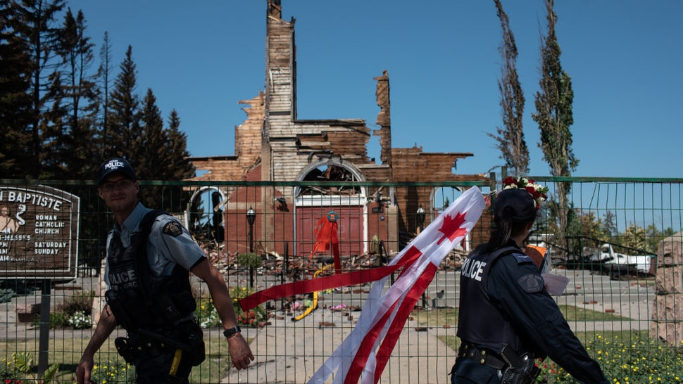 ALBERTA, CANADA - JULY 01: Firefighters inspect the damage at the Roman Catholic St. Jean Baptiste church destroyed by fire in Morinville, Alberta on Thursday, July 1, 2021.