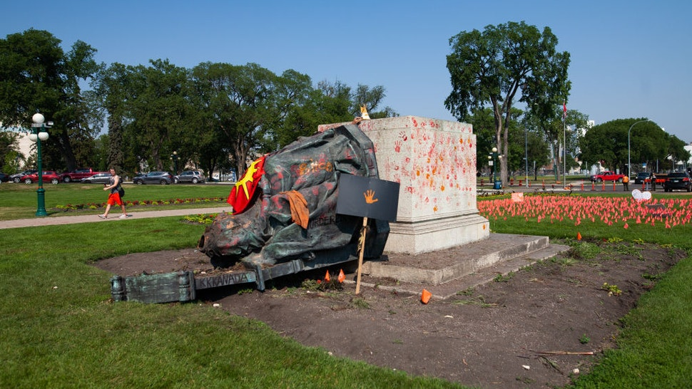 WINNIPEG, CANADA - JULY 02: A toppled statue of Queen Victoria on the grounds of the Manitoba Legislature on July 2, 2021 in Winnipeg, Manitoba, Canada. The statue was pulled down by indigenous protestors following a march to honour survivors and victims of Canadaâs residential school system.