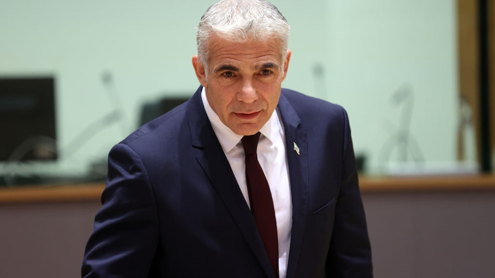 BRUSSELS, BELGIUM - JULY 12: Israeli Foreign Minister Yair Lapid attends the EU Foreign Ministers' meeting in Brussels, Belgium on July 12, 2021.