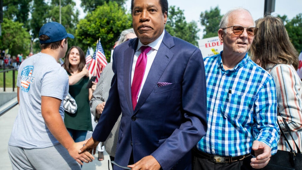 Norwalk, CA - July 13:Larry Elder arrives at the Norwalk Registrar of Voters on Tuesday, July 13, 2021 to file paperwork announcing his run for governor in the California recall election.