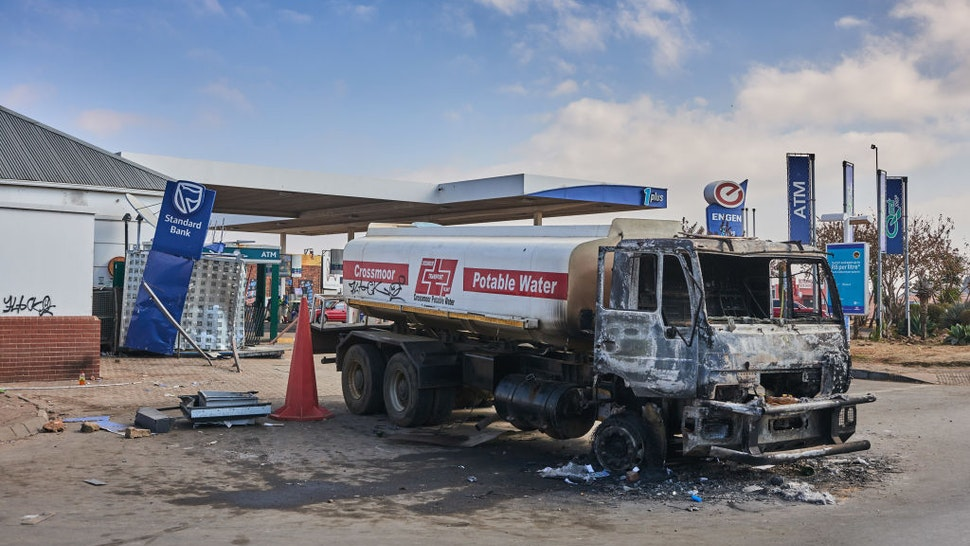 A burnt out water tanker by a damaged Engen Ltd. gas station following rioting in the Soweto district of Johannesburg, South Africa, on Thursday, July 15, 2021. Marauding mobs have ransacked hundreds of businesses and destroyed telecommunications towers and other infrastructure, while transport networks and a program to vaccinate people against the coronavirus have been disrupted. Photographer: Waldo Swiegers/Bloomberg via Getty Images