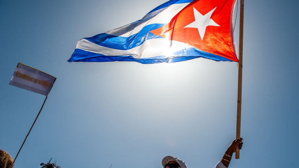 AMSTERDAM, NETHERLANDS - 2021/07/17: A protester holds a Cuban flag during the demonstration.
