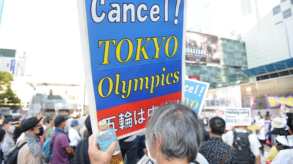 TOKYO, JAPAN - JULY 23 : People protest against the Opening ceremony of 2020 Tokyo Summer Olympic Games on July 23, 2020 in Tokyo, Japan, as they ask for the cancel of the Games a few hours ahead of the Opening ceremony of the Tokyo Games. (Photo by David Mareuil/Anadolu Agency via Getty Images)