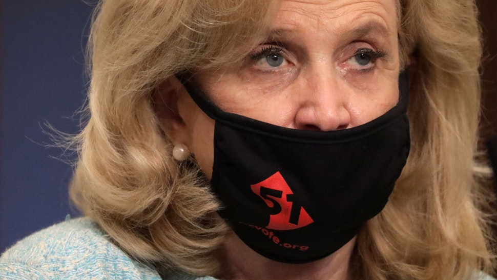 U.S. Rep. Carolyn Maloney (D-NY) wears a DC Vote mask as she waits for the beginning of a hearing before the Coronavirus Crisis Subcommittee of House Oversight and Reform Committee June 26, 2020 on Capitol Hill in Washington, DC.
