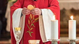 Midsection Of Priest In Church