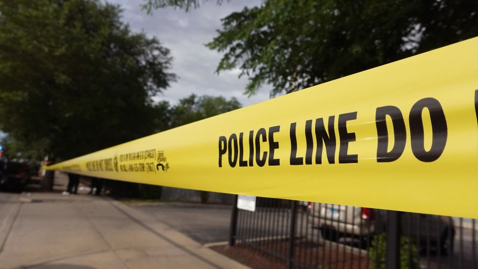 CHICAGO, ILLINOIS - JUNE 23: Police tape surrounds a crime scene where three people were shot at the Wentworth Gardens housing complex in the Bridgeport neighborhood on June 23, 2021 in Chicago, Illinois. A 24-year-old man died from injuries he suffered in the shooting and two others, a 22-year-old male and a 25-year-old male, were seriously wounded. (Photo by Scott Olson/Getty Images)