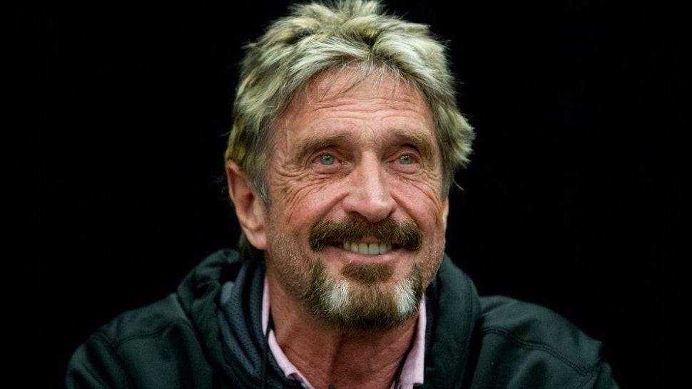 """SAN JOSE, CALIFORNIA - SEPTEMBER 28: John McAfee reacts to a question at the """"Fireside Chat with John McAfee"""" talk during the C2SV Technology Conference + Music Festival at the McEnery Convention Center in San Jose, Calif., on Saturday, Sept. 28, 2013."""
