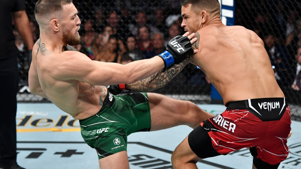 LAS VEGAS, NEVADA - JULY 10: (L-R) Conor McGregor of Ireland kicks Dustin Poirier in their welterweight fight during the UFC 264 event at T-Mobile Arena on July 10, 2021 in Las Vegas, Nevada. (Photo by Jeff Bottari/Zuffa LLC)