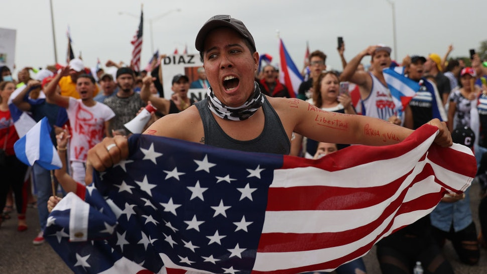 MIAMI, FLORIDA - JULY 13: Protesters shut down part of the Palmetto Expressway as they show their support for the people in Cuba that have taken to the streets to protest on July 13, 2021 in Miami, Florida. On Sunday, thousands of Cubans took to the streets across the country to protest pandemic restrictions, the pace of Covid-19 vaccinations and the Cuban government. (Photo by Joe Raedle/Getty Images)