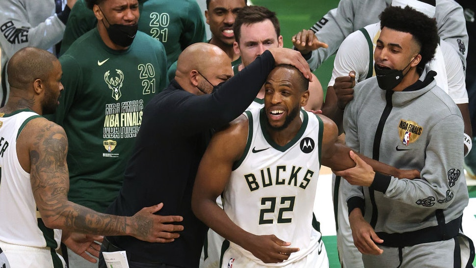 MILWAUKEE, WISCONSIN - JULY 14: Khris Middleton #22 of the Milwaukee Bucks is congratulated by teammates during the second half in Game Four of the NBA Finals against the Phoenix Suns at Fiserv Forum on July 14, 2021 in Milwaukee, Wisconsin. NOTE TO USER: User expressly acknowledges and agrees that, by downloading and or using this photograph, User is consenting to the terms and conditions of the Getty Images License Agreement. (Photo by Jonathan Daniel/Getty Images)