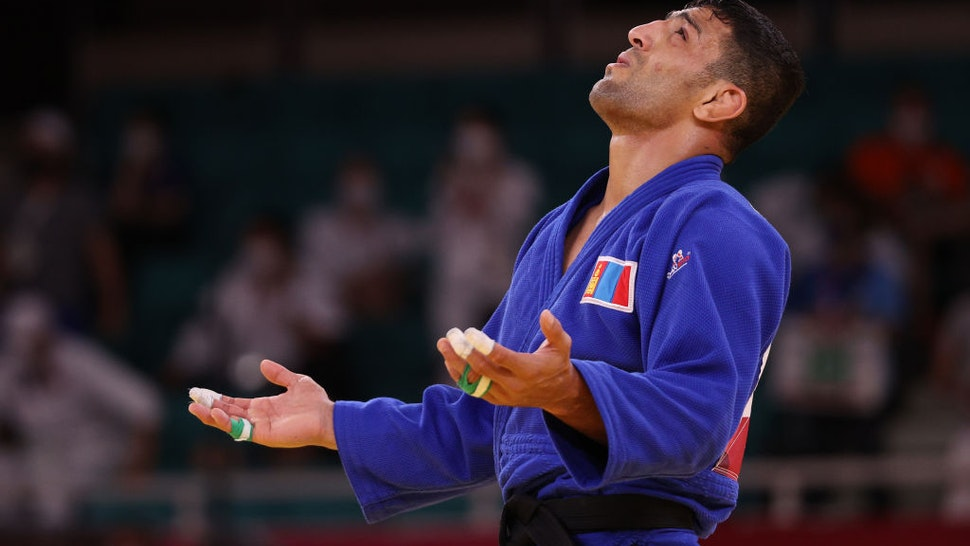 TOKYO, JAPAN - JULY 27: Saeid Mollaei of Team Mongolia reacts after he defeated Shamil Borchashvili of Team Austria during the Men's Judo 81kg Semifinal of Table B on day four of the Tokyo 2020 Olympic Games at Nippon Budokan on July 27, 2021 in Tokyo, Japan. (Photo by Harry How/Getty Images)