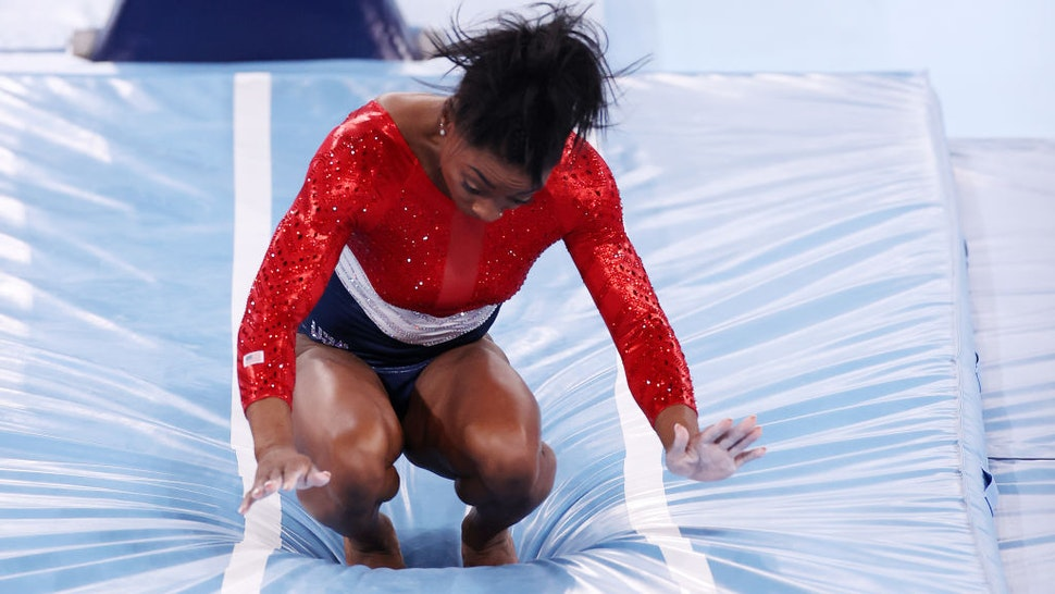 TOKYO, JAPAN - JULY 27: Simone Biles of Team United States stumbles upon landing after competing in vault during the Women's Team Final on day four of the Tokyo 2020 Olympic Games at Ariake Gymnastics Centre on July 27, 2021 in Tokyo, Japan. (Photo by Jamie Squire/Getty Images)