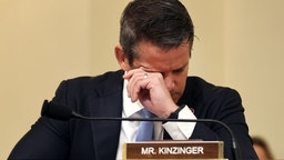 WASHINGTON, DC - JULY 27: U.S. Rep. Adam Kinzinger (R-IL) wipes his eyes as he listens to testimony during a hearing by the House Select Committee investigating the January 6 attack on the U.S. Capitol on July 27, 2021 at the Cannon House Office Building in Washington, DC. Members of law enforcement testified about the attack by supporters of former President Donald Trump on the U.S. Capitol. According to authorities, about 140 police officers were injured when they were trampled, had objects thrown at them, and sprayed with chemical irritants during the insurrection. (Photo by Chip Somodevilla/Getty Images)