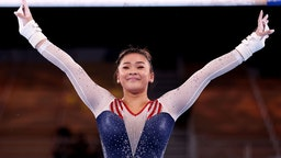 Sunisa Lee of Team United States reacts after competing on uneven bars during the Women's All-Around Final on day six of the Tokyo 2020 Olympic Games at Ariake Gymnastics Centre on July 29, 2021 in Tokyo, Japan.