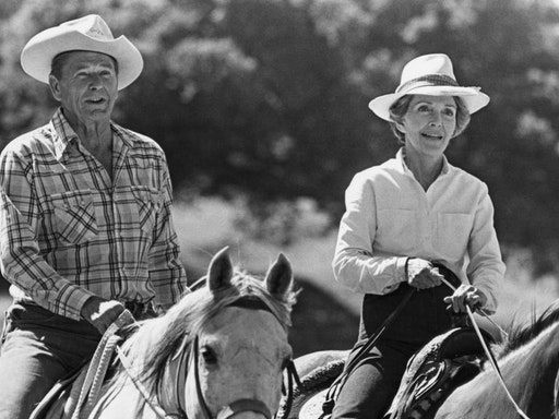 10th January 1981: US President Ronald Reagan and First Lady Nancy Reagan ride horses next to each other. Photograph probably taken at their ranch in Santa Barbara, California. (Photo by Express/Express/Getty Images)