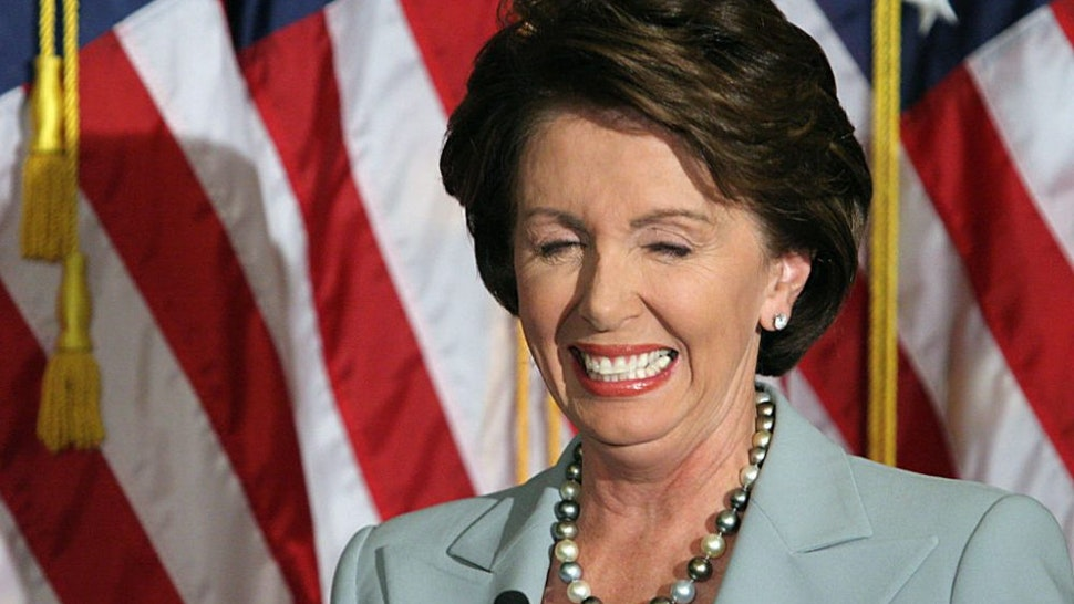 Democratic House leader Nancy Pelosi laughs at a question during a press conference 08 November 2006 on Capitol Hill in Washington, DC. Pelosi is set to become the first female speaker of the US House of Representatives following the 07 November elections. She has called for the resignation of US Secretary of Defense Donald Rumsfeld which was announced 08 November by US President George W. Bush.