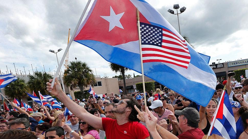 TOPSHOT - Cuban Americans in Miami's Little Havana celebrate the death of longtime Cuban leader Fidel Castro on November 26, 2016.