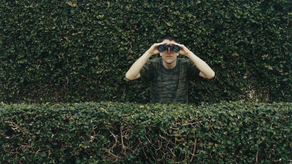 Man Using Binoculars - stock photo