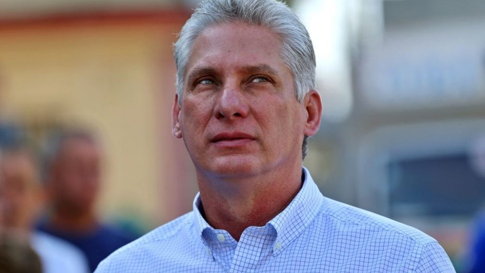 Cuba's First Vice-President Miguel Diaz-Canel queues at a polling station in Santa Clara, Cuba, during an election to ratify a new National Assembly, on March 11, 2018. - Cubans vote to ratify a new National Assembly on Sunday, a key step in a process leading to the election of a new president, the first in nearly 60 years from outside the Castro family. The new members of the National Assembly will be tasked with choosing a successor to 86-year-old President Raul Castro when he steps down next month.